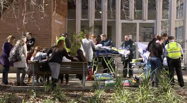 Injured students are treated after the horrific attack at Australian National University in Canberra (Australian Broadcasting Corporation/AP)