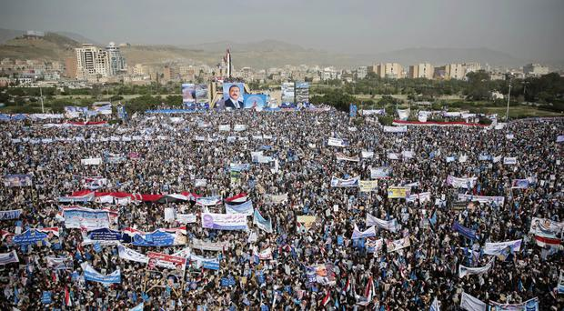 Supporters of former Yemeni President Ali Abdullah Saleh mark the 35th anniversary of the founding of the Popular Conference Party in Sana'a amid rising tension between his loyalists and Shiite Houthi rebels (AP Photo/Hani Mohammed)