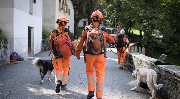 A search and rescue team arrives in Bondo, Graubuenden, southern Switzerland (Keystone/AP)
