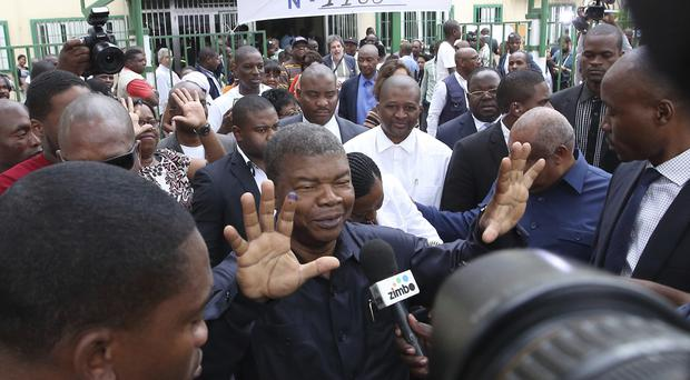 Joao Lourenco faces the media after casting his vote on Wednesday (AP)