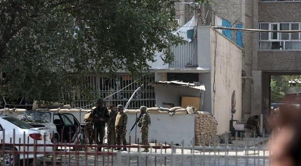 Afghan security personnel arrive at the site of an explosion near a bank in Kabul (AP Photo/Rahmat Gul)