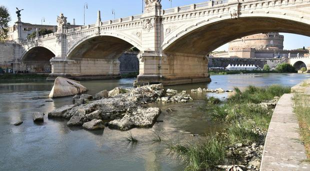 Water levels in the Tiber river are particularly low due to the drought (Ansa/AP)