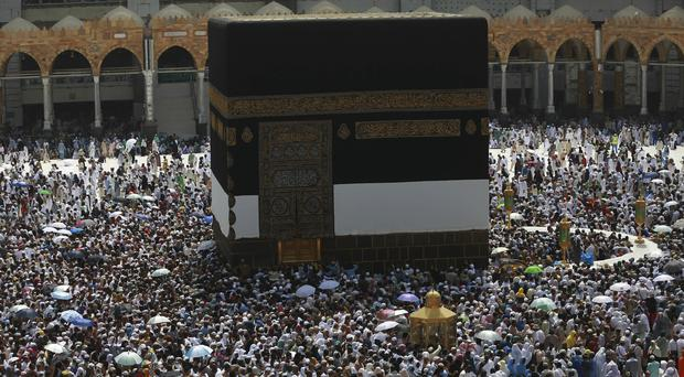 Muslim pilgrims pass around the Kaaba, the cubic building at the Grand Mosque, Mecca. (AP)