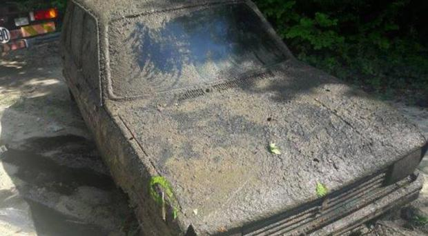 A Peugeot 104 recovered this week in France's Champagne country, 38 years after it was stolen (Gendarmerie Nationale via AP)