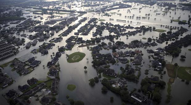 Floodwaters from Tropical Storm Harvey surround homes in Port Arthur, Texas (AP Photo/Gerald Herbert)