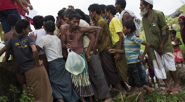 Rohingyas living in no man's land collect water donated by Bangladesh Red Crescent members (AP Photo/Bernat Armangue)