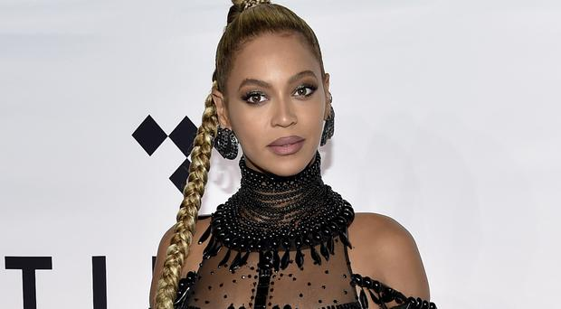 Beyonce is also working with her charity to assist those in her home town affected by Tropical Storm Harvey (Invision/AP)