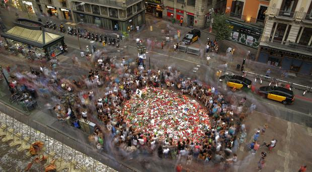 A memorial tribute of flowers, messages and candles to victims of a terror attack in Barcelona's historic Las Ramblas (AP Photo/Manu Fernandez, File)