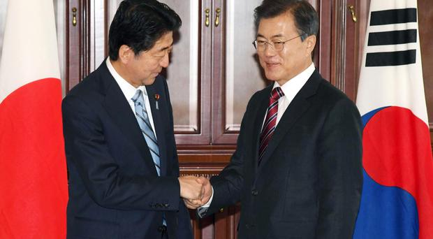 Japanese Prime Minister Shinzo Abe met South Korean President Moon Jae-in on Wednesday (AP)