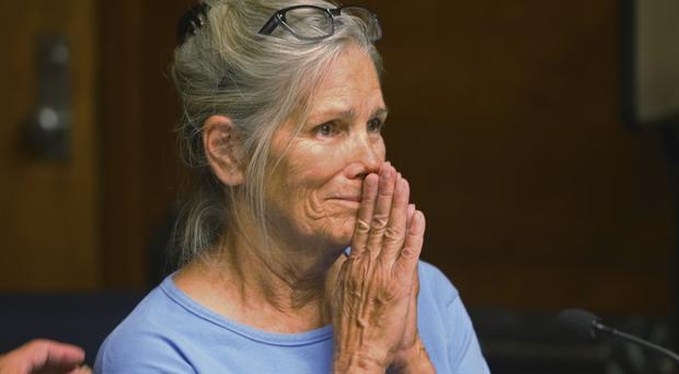 Leslie Van Houten hears she is eligible for parole during a hearing in Corona, California (Los Angeles Daily News/AP)