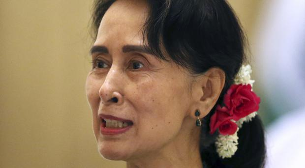 Aung San Suu Kyi became de facto leader after Burma held its first free election in 2012 and she led her party to a landslide victory (AP)