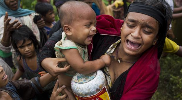 A Rohingya woman breaks down after a fight erupted during food distribution (AP/Bernat Armangue)