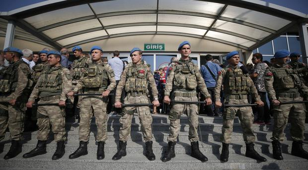 Turkish army soldiers stand guard outside court (AP/Emrah Gurel)