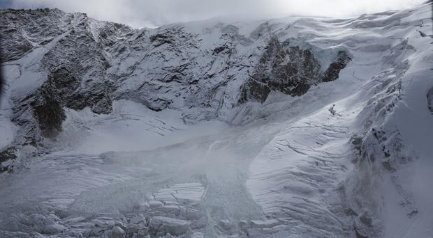 The glacial ice avalanche of the Trift glacier in Saas-Grund, Valais, Switzerland (Dominic Steinmann/Keystone via AP)