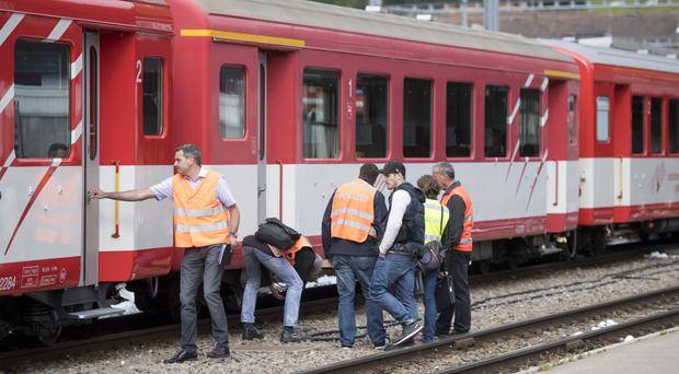 Officials investigate at the train station in Andermatt, Switzerland (Urs Flueeler/Keystone via AP)