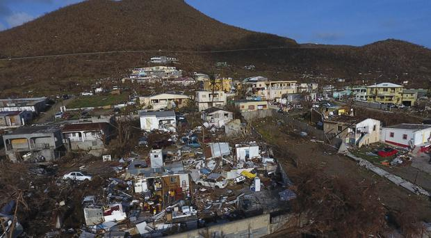 Storm damage in the aftermath of Hurricane Irma in the Cole Bay community of St Martin (Joel Antonio Colon/AP)