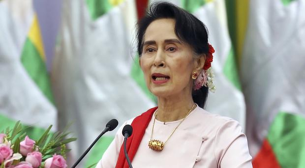Aung San Suu Kyi is not Burma's president but effectively serves as leader (AP)