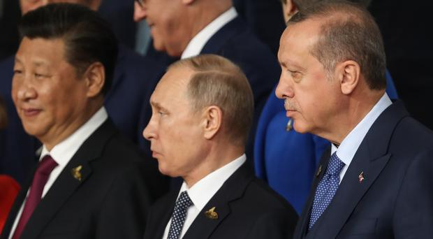 Turkey's president Recep Tayyip Erdogan (right) with Russian president Vladimir Putin (centre)