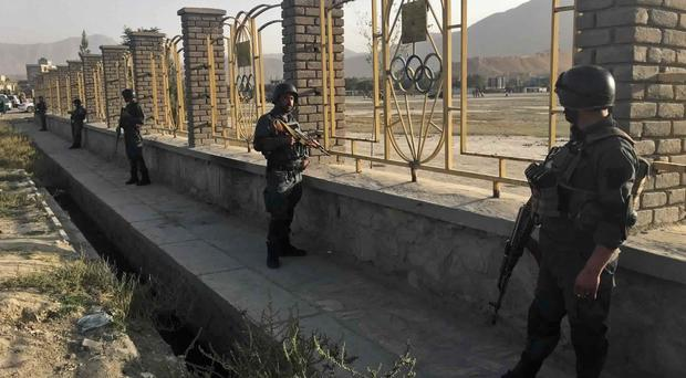 Afghan security police stand guard near the site of a deadly suicide attack outside a cricket stadium, in Kabul, Afghanistan (AP)