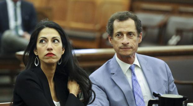 Anthony Weiner, right, with estranged wife Huma Abedin, an aide to Hillary Clinton