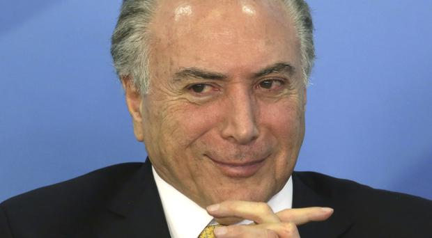 President Michel Temer has repeatedly denied any wrongdoing (AP Photo/Eraldo Peres)