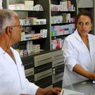 Mokhtar Agrebi, left, and Latifa Trabelsi work in a pharmacy in Tunis. Tunisia's president has vowed to make inheritance and marriage rules fairer to women (AP/Hassene Dridi)