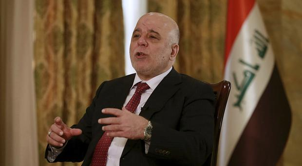 Iraq's Prime Minister Haider al-Abadi says he is prepared to use military force if the Kurdish region's planned referendum results in violence (AP Photo/Khalid Mohammed)