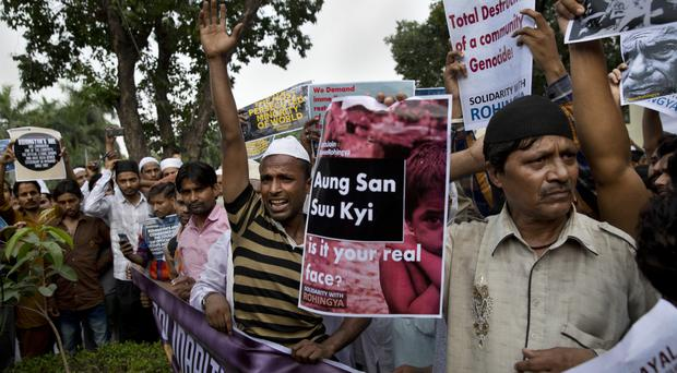 Indian muslims hold placards and shout slogans during a protest against the persecution of Rohingya Muslims (AP)