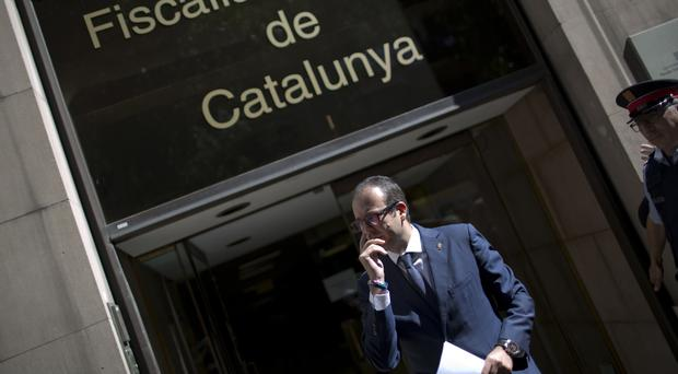 Spanish police raid Catalan government offices, arrest top official