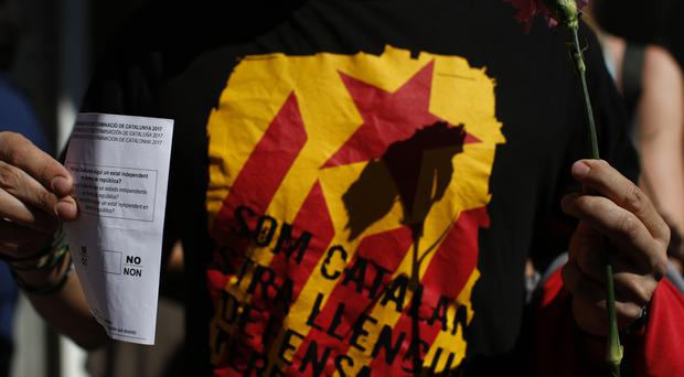 A protester holding an unofficial ballot paper (AP)