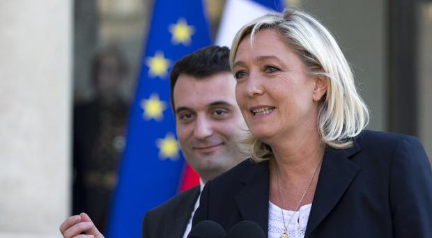 Florian Philippot has quite the National Front after a rift with Marine Le Pen (right) (AP)