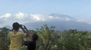 A man observes Mount Agung from a viewing point in Bali (AP)