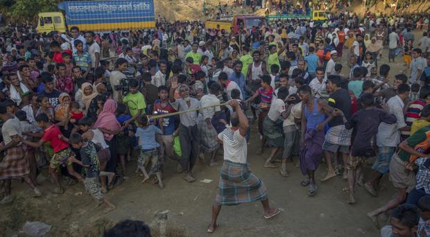 A Rohingya, who crossed over from Burma into Bangladesh, clashes with other refugees