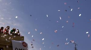 People throw ballot papers to the crowd in Barcelona, Spain (AP)