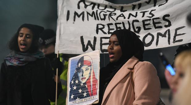 Protests were held across the UK against US President Donald Trump's controversial travel ban on refugees and people from seven mainly-Muslim countries.