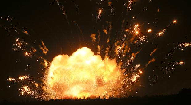 A powerful explosion in the ammunition depot at a military base in Kalynivka, south-west of Kiev, Ukraine (AP Photo/Efrem Lukatsky)