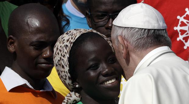 Pope Francis meeting a group of migrants on Wednesday (AP)