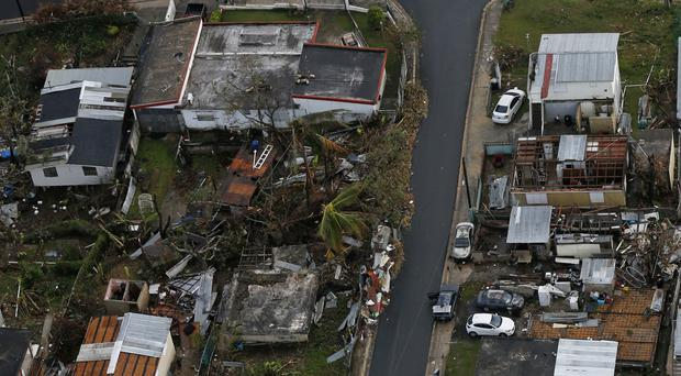 Damaged and destroyed homes are seen in the aftermath of Hurricane Maria in Toa Alta, Puerto Rico (AP)