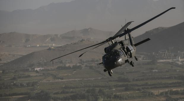 Stock picture of a helicopter over Kabul