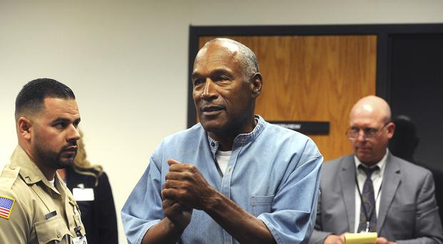 Former NFL football star OJ Simpson reacts after learning he has been granted parole (AP)