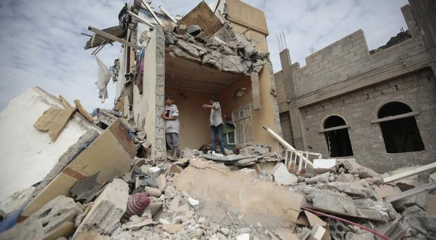 File photo showing the rubble of a house destroyed by Saudi-led airstrikes in Sanaa, Yemen (AP)