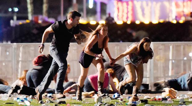People run from the Route 91 Harvest country music festival. (Photo by David Becker/Getty Images)
