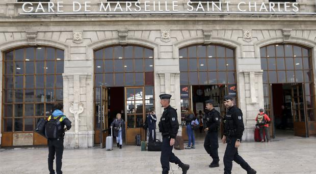 Police officers outside Marseille's Saint Charles station after a man stabbed two women to death (AP Photo/Claude Paris)