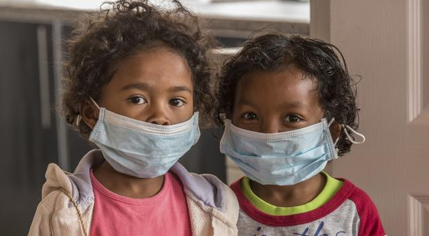 Children wear face masks at a school in Antananarivo, Madagascar (AP)