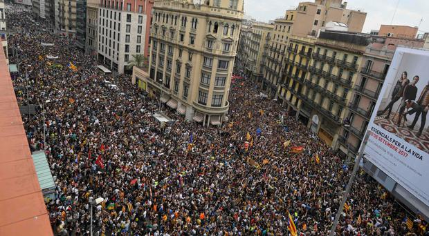 Protesters gather at the Placa de la Universitat square in Barcelona during the general strike yesterday