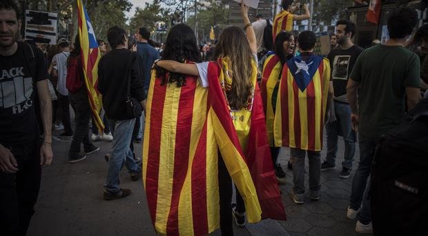 The court said the four will be quizzed about their roles in demonstrations in Barcelona in September (AP Photo/Santi Palacios)