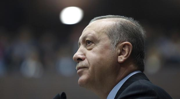 The defendants were charged with attempting to kill President Recep Tayyip Erdogan in the coup attempt last year (AP)