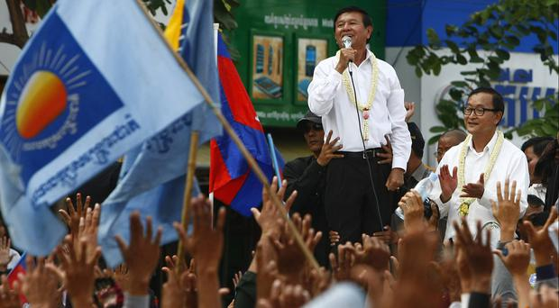 File photo from 2013 of former party leaders of Cambodia National Rescue Party, Kem Sokha, second right, and Sam Rainsy (AP)