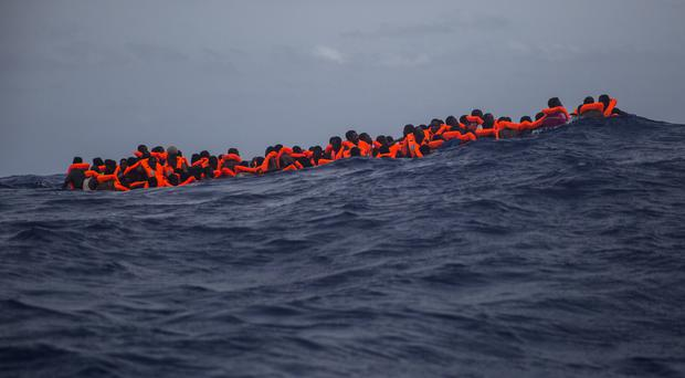 Migrants waiting to be rescued from the Mediterranean Sea