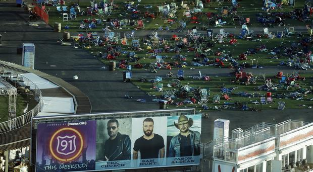 Personal belongings and debris litters the Route 91 Harvest festival grounds across the street from the Mandalay Bay resort and casino in Las Vegas. (AP Photo/Marcio Jose Sanchez)